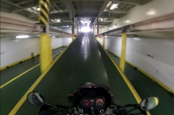 Heading up the ramp into the sunshine after a 16 hour ferry ride. Photo: Nathaniel Chaney