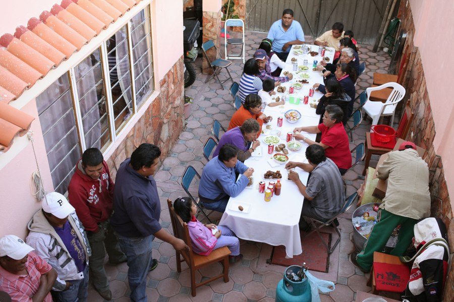 The first round of guests sits down to plates of carnitas at a Huichan family party. Photo: Alex Washburn