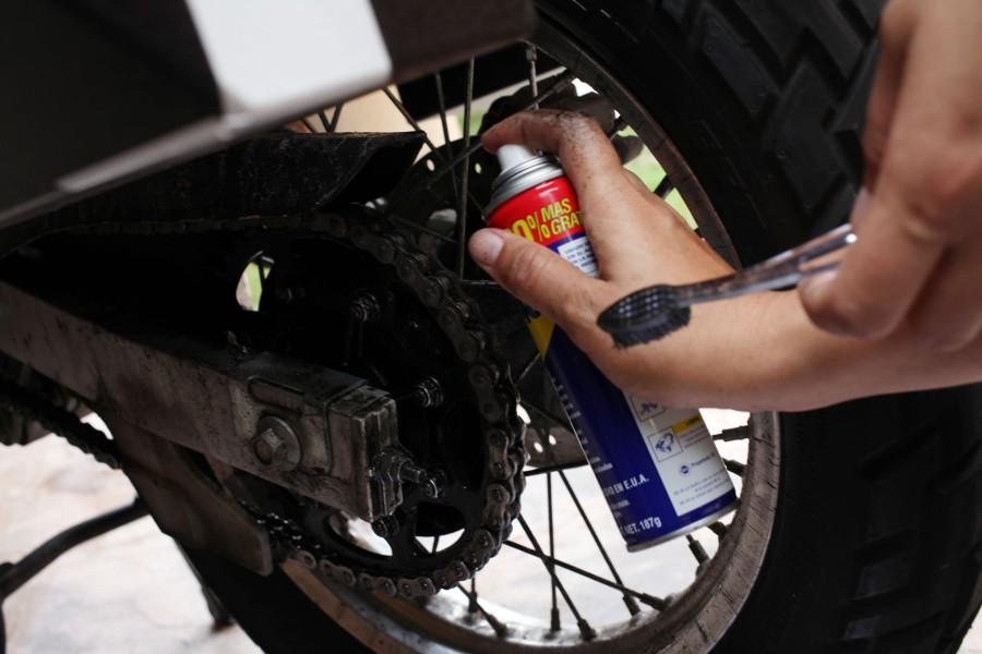 Motorcycle maintenance before we take off tomorrow. WD40 and some chain lube. (Photo: Nathaniel Chaney)