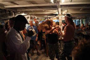 A couple dances to the music of a local band at the Barrier Reef Sports Bar and Grill on Caye Caulker. Photo: Alex Washburn