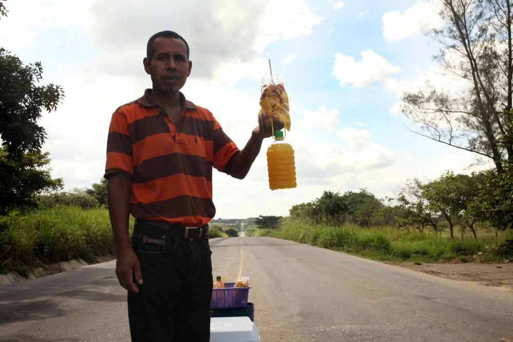 One of the Piña vendors we talked to along Highway 145. They juice it, bottle it, ice it and sell it the same day. Photo: Alex Washburn