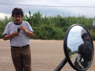 Hector stands on the side of the road as Alex readies to leave for Belize City (Photo: Alex Washburn)