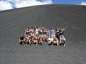 We pose for a photo with our fellow Volcano Boarders at the end of our Big Foot Hostel Tour. Photo: Our Guide Jose