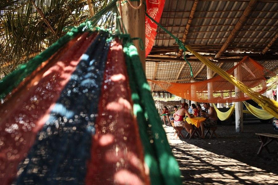 Families relax near the beach in Sunzal El Salvador. Photo: Alex Washburn
