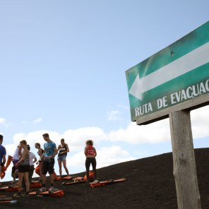 A cheeky evacuation sign points to the area where you go off the side of Cerro Negro. Photo: Alex Washburn