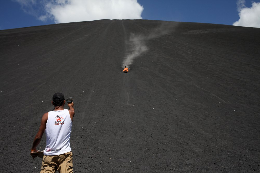 Our secondary guide waits at the bottom of Cerro Negro with a speed gun. Photo: Alex Washburn
