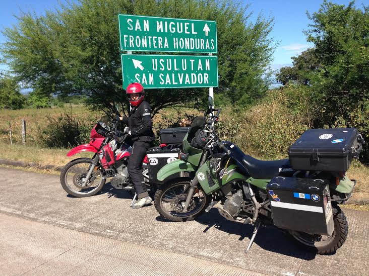 Alex poses next to a sign showing we are close to the Honduran border. Photo: Nathaniel Chaney