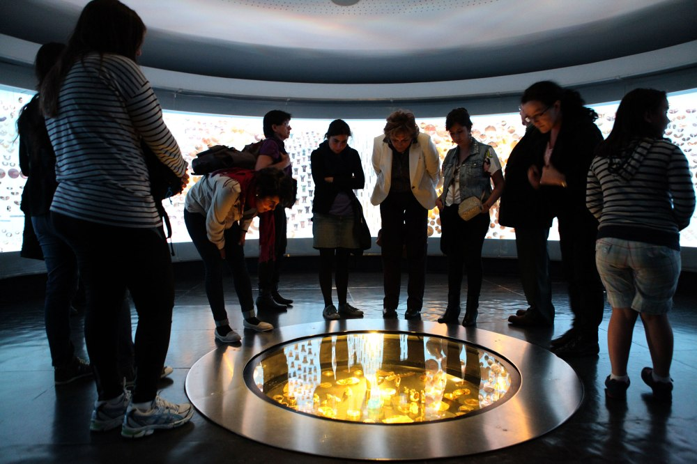 A group of tourists checks out a display at the Museo de Oro (Gold Museum) in downtown Bogota. Photo: Alex Washburn