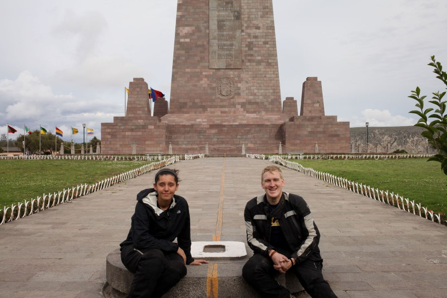 We pose on each side of the equator line at the La Mitad Del Mundo monument just outside of Quito. Photo: Alex Washburn