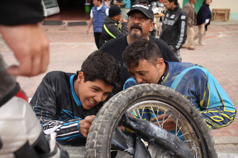 One of the smaller dirt bikes got a flat and everyone wanted to help... since that's impossible most of us stood around talking while they worked. Photo: Alex Washburn