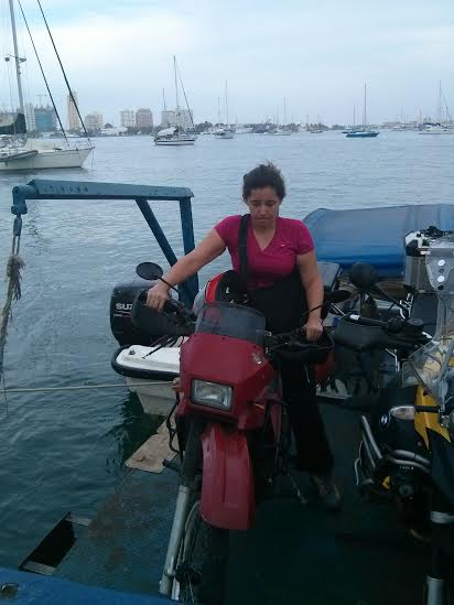 Alex nervously balances her bike on the floating dock that carried our six bikes from the Stahlratte to land in Cartagena. Photo: Alex Washburn