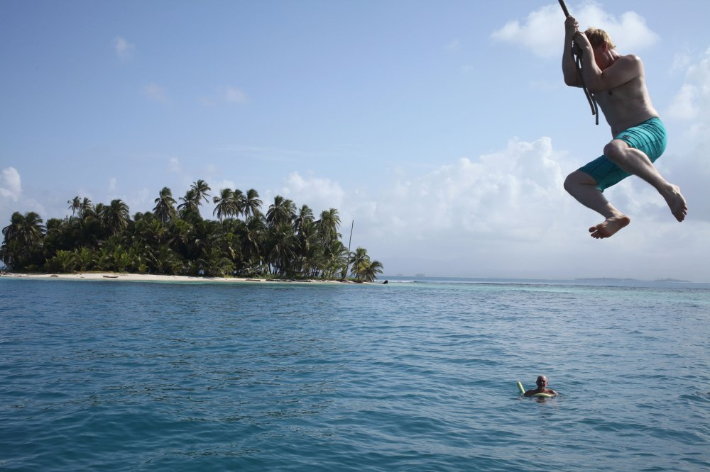 Nathaniel uses the Stahlratte's rope swing to jump into the ocean. Photo: Alex Washburn