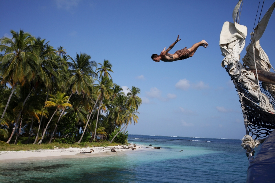 A frenchman jumps off the bow of the Stahlratte into the Caribbean Sea. Photo: Alex Washburn