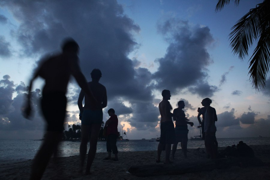 Passengers of the Stahlratte make conversation on the beach before heading back to the boat for the night. Photo: Alex Washburn