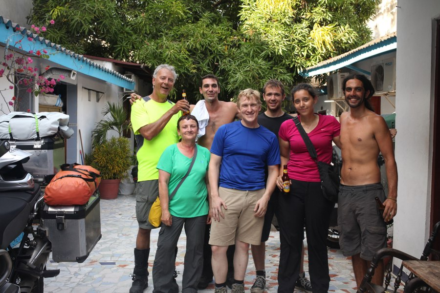 Ken, Diana, Jesse, Taylor, Nico, Nathaniel and I pose for a photo after victoriously getting our bikes through Aduana and the Colombian insurance office (it took all day). Photo: Alex Washburn