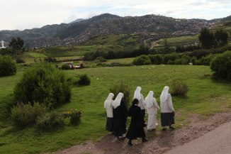 A group of nuns walks from the hills down into Cusco. Photo: Alex Washburn