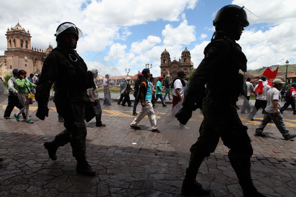 Police monitor protestors as they march through Cusco, Peru on Tuesday, Feb. 25, 2013. Photo: Alex Washburn