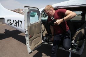 Nathaniel exits the 6 passenger Cessna after our tour. Photo: Alex Washburn