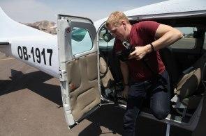 Nathaniel exits the 6 passenger Cessna after our tour. Photo: Alex Washburn
