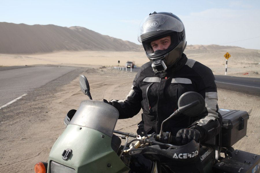 We stopped for a quick photo break 200 miles(isn) north of Lima. We were tired and dehydrated when we finally arrived although this desert is not actually that hot. Photo: Alex Washburn