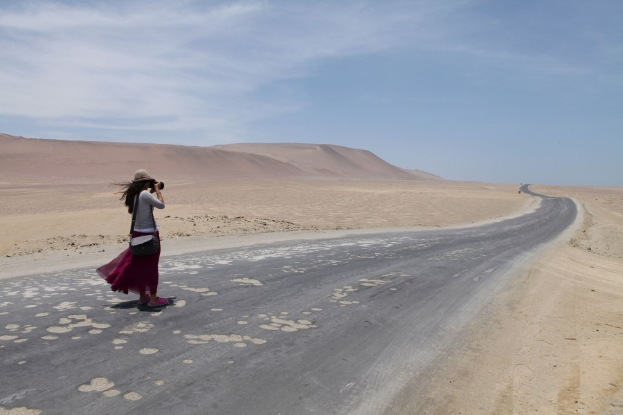 One of our fellow tourists (from Hong Kong) at Reserva Nacional de Paracas. Photo: Alex Washburn
