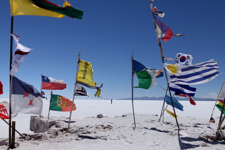 If you visit the Salar de Uyuni I would suggest bringing a flag to add to the collection near the buildings where most of the tours stop for lunch. The fluttering colors are gorgeous against the the duo-chromatic surroundings.  Photo: Alex Washburn