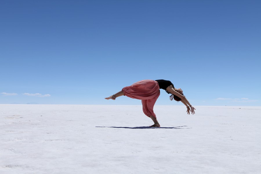 A Brazilian girl dances for her boyfriend's camera on the Salar de Uyuni. Tourists usually bring props to play with the strange perspective the salt flat creates but this was positively ethereal. Photo: Alex Washburn