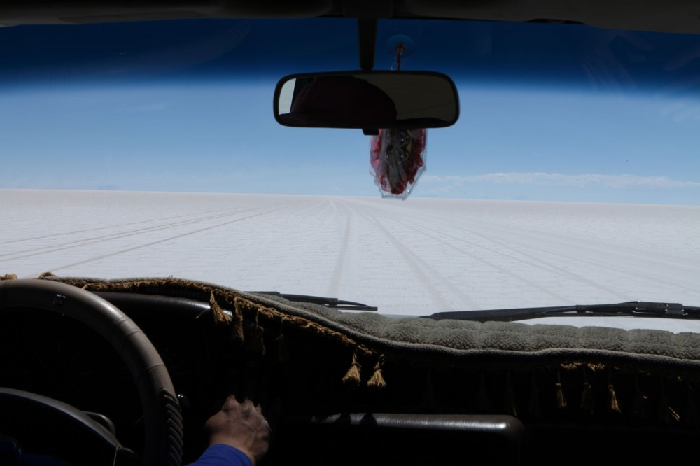 Driving through the Salar de Uyuni is a strange experience. White hard packed salt stretches for miles in every direction and the local guides navigate across the expanse of nothingness using the surrounding mountains as navigational markers. Once we got out onto the salt flat we were glad we hadn't driven out there alone. Photo: Alex Washburn