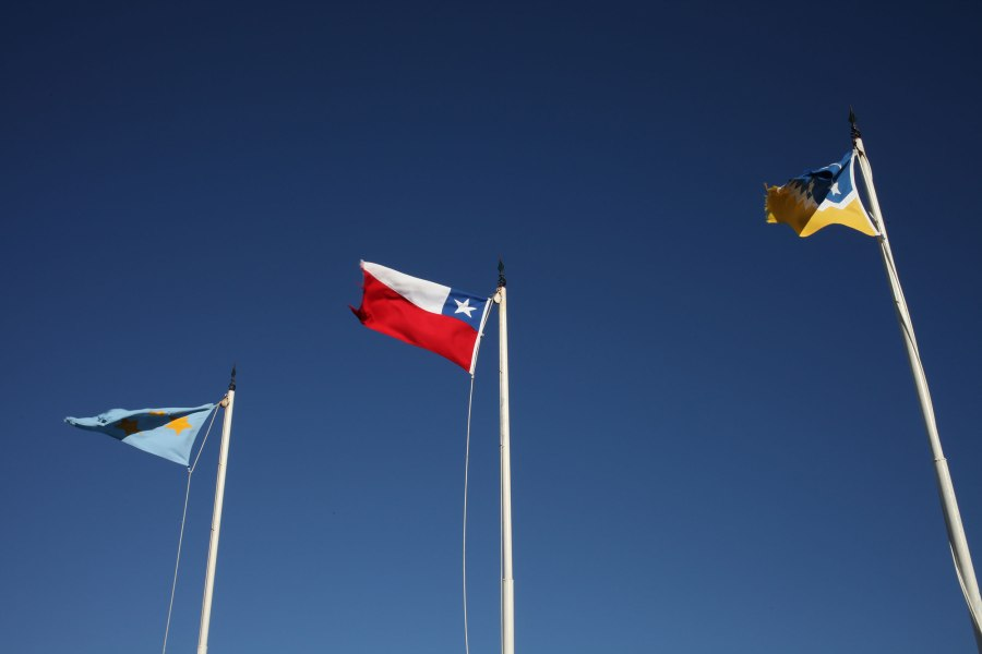 Flags flap restlessly overlooking the Strait of Magellan. Photo: Alex Washburn