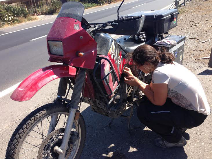 Alex tries to get her bike moving again on the side of the freeway. Photo: Alex Washburn
