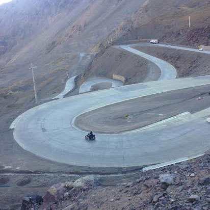 A Harley-Davidson starts to make its way down the infamous snail pass of Chile. Photo: Alex Washburn